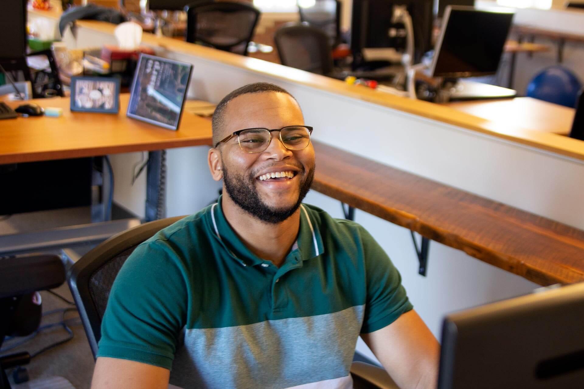 Caktus developer Christopher Dixon at his desk