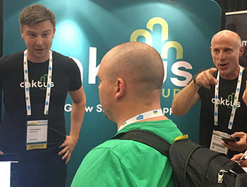 Caktus staff at their booth during PyCon 2019