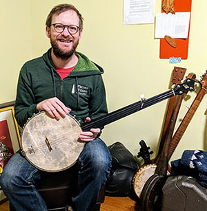 Dane Summers with his fretless banjo.