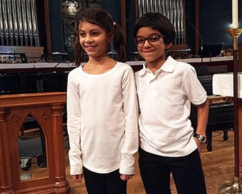 Developer Vinod Kurup's daughter and niece, who are members of the Sisters' Voices choir.
