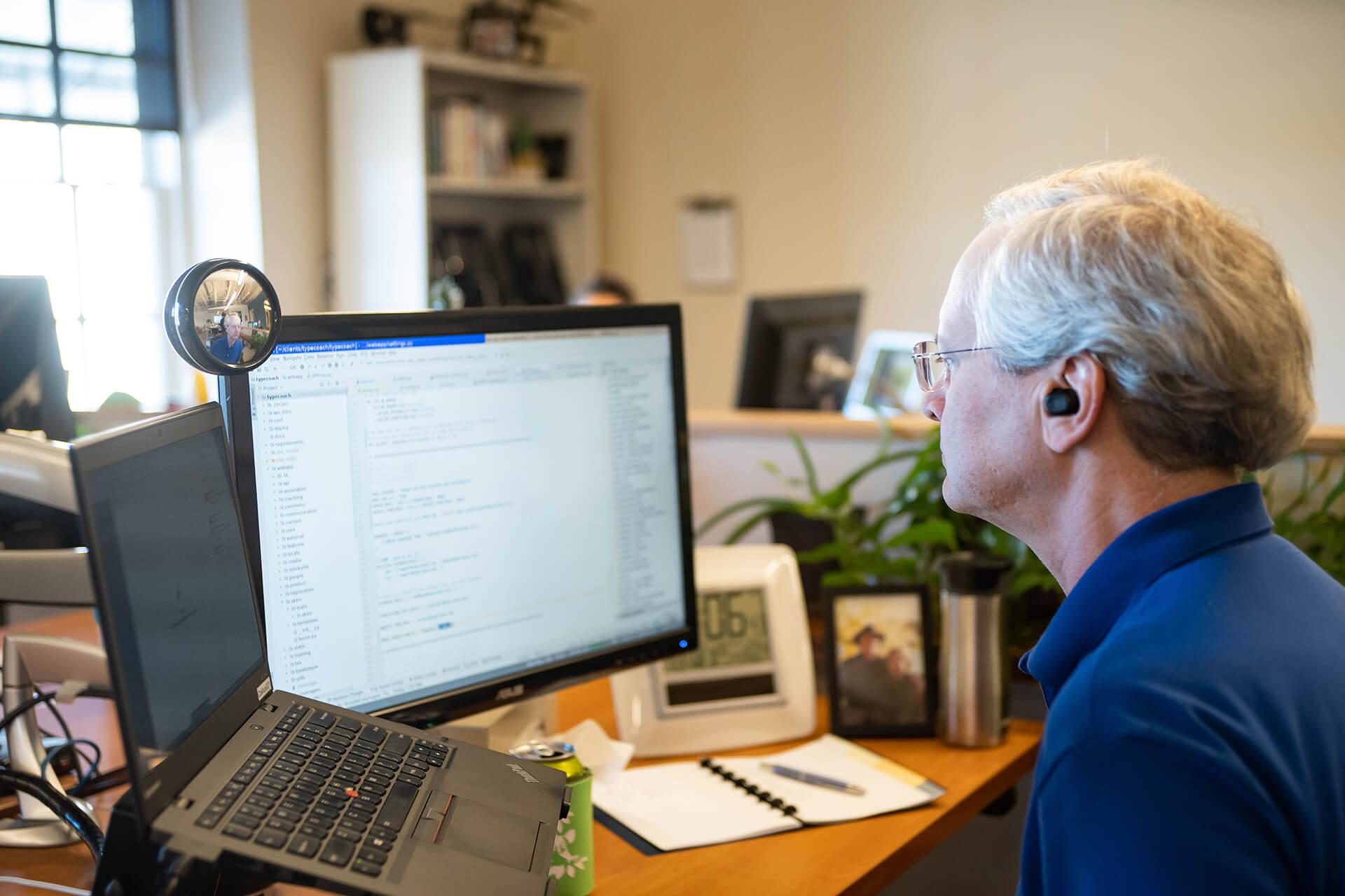 Developer working at desk