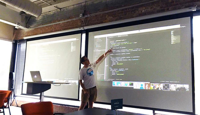 Neil presenting during ShipIt Day - July 2016 - Caktus Group